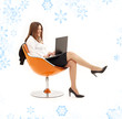 businesswoman with laptop in orange chair with snowflakes