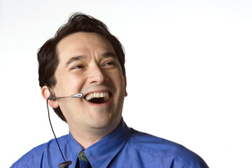 Asian American man wearing telephone heasdset