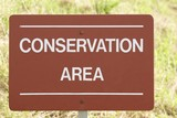 sign for area of conservation. saving the environment poster