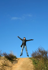 girl in top with open arms - symbol of freedom