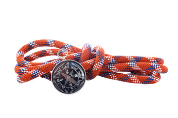 Compass and rope with knot reflected on white background