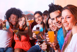 group of happy friends smiling in a bar or a nightclub poster