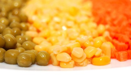 Green peas, sweet corn and carrot on white plate