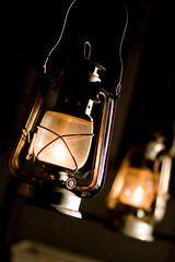 Old fashioned lantern in darkness. Light concept...
