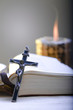 Old Cross and the Holy Bible laying on the table