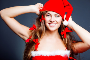 Beautiful cheerful Santa helper girl