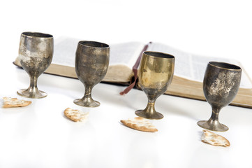 Four small cups with wine and bread. Communion