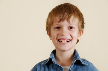 Young caucasian smiling boy in blue shirt