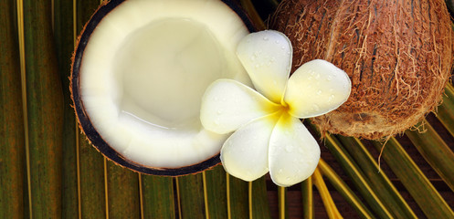 spa beauty exotic tropical flowers coconuts on palm leaf