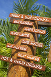 wooden sign with beverages in front of restaurant in tropics poster