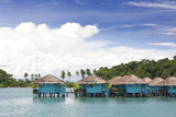 blue cabins built on pillars in water, koh chang, thailand poster