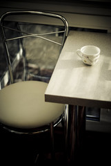 a Dining table with a cup