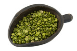 green split peas on a primitive, wooden scoop isolated poster
