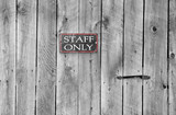 staff only sign on an old wooden door poster