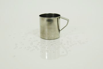 Stainless steel cup for drinking or holding items.