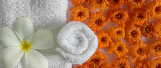 spa beauty exotic tropical flowers  on white towels