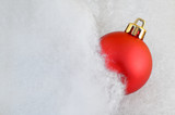 Close up of a red bauble in fluffy cotton with copy space poster