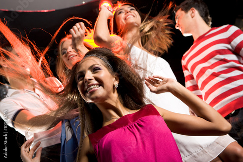 Joyful girl having fun in club