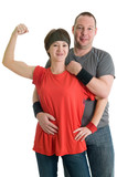 Young couple - girl is showing her biceps, man is behind her poster