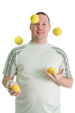 Young man juggling with tennis balls. Isolated over white poster