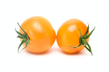 Orange tomatoes isolated on white
