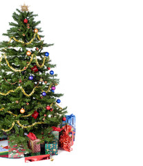An isolated Christmas tree ready for Santa.