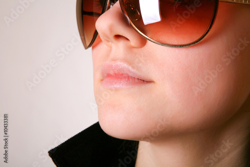 Woman in sunglasses. Fashion portrait.