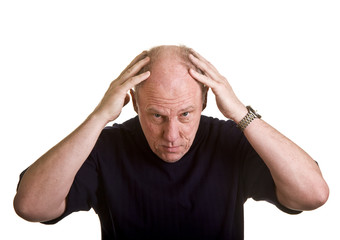 An older man leaning over with his hands on his bald head