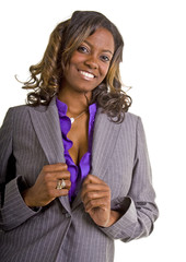 A black businesswoman in a grey suit