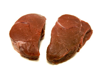 Two fillet mignon steaks on a white background