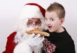 toddler and santa sharing pizza slice poster