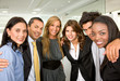 group of business people in an office smiling - small team