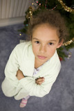 Young Girl Upset in front of the Christmas Tree poster