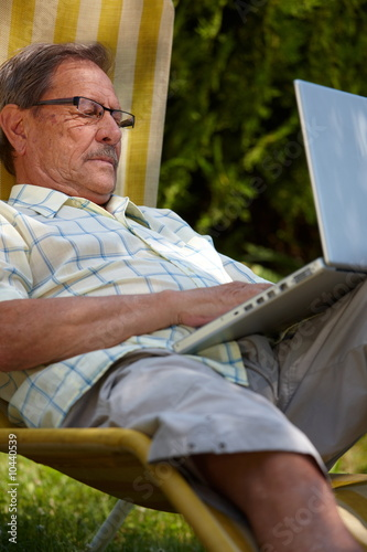 Healthy senior man is his elderly 70s sitting outdoor