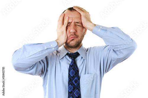 Businessman in depression with hands on head isolated over white
