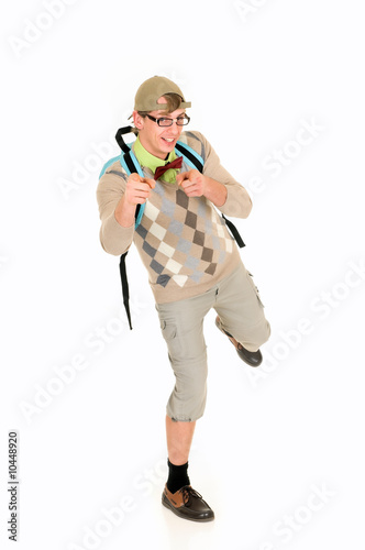 Young nerd with bow tie, shorts and cap, wearing backpack.