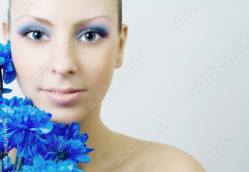 Beautiful woman with blue flowers.