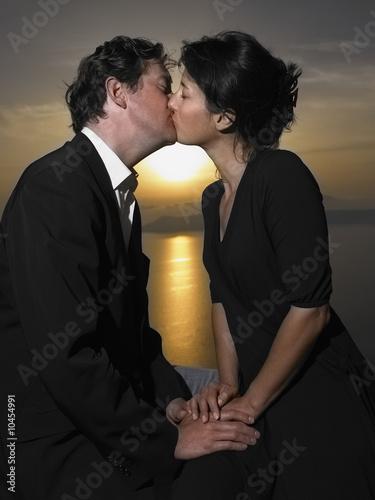 couple kissing sunset. Couple kissing, sunset
