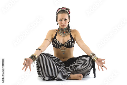 Girl in native clothes meditating isolated on white
