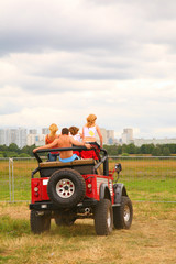 People in jeep from back and fence