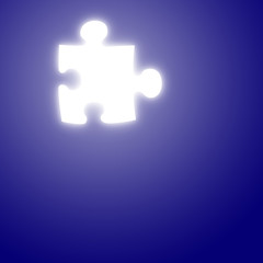 glowing puzzle piece on a blue background