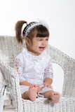Little Girl Sitting in a rotton armchair crying poster