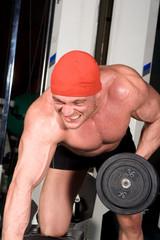 Bodybuilder training in the gym
