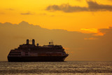 Large cruise ship at sunrise in a journey into the horizon poster