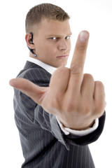 businessman with vulgar hand gesture with white background