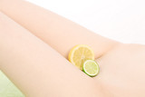 Nude body with lemon and lime, high key poster
