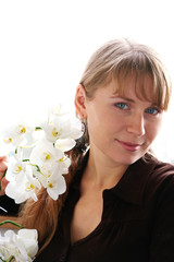 Beautiful young smiling woman with white orchids