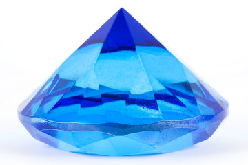 Blue glass polyhedron toy isolated on white background