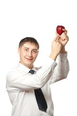 businessman showing red apple
