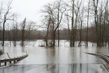 Flood waters over road